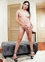 Lacey has a slender body with a big cock! Watch this cute young Latina posing and having fun!